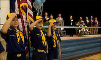 Elementary school boys participate as flag bearers during a ceremony.  Editorial use only.