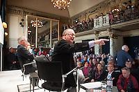 """Der rechte SPD-Populist Thilo Sarrazin sollte am Sonntag den 2. Maerz 2014 auf Einladung des Politmagazin Cicero im Berliner Ensemble sein umstrittenes Buch """"Der Neue Tugendterror - Ueber die Grenzen der Meinungsfreiheit in Deutschland"""" vorstellen. Ca. 300 Menschen protestierten davor gegen seinen Auftritt in dem von Berthold Brecht gegruendeten Theater.<br />Etwa 20 Personen von Antirassitischen Gruppen gelang es im Publikum Platz zu nehmen. Mit Einmarsch von Sarrazin riefen sie laut Parolen gegen den ihrer Meinung nach Rassisten und hielten Plakate hoch. Anhaenger Sarrazins gingen zum Teil handgreiflich auf die Protestierer los. Die Veranstaltung musste nach ca. 30 Minuten abgebrochen werden ohne das Sarrazin eine seiner Thesen vortragen konnte.<br />Im Bild: Der Veranstaltungsleiter weist Protestierer zu Recht.<br />2.3.2014, Berlin<br />Copyright: Christian-ditsch.de<br />[Inhaltsveraendernde Manipulation des Fotos nur nach ausdruecklicher Genehmigung des Fotografen. Vereinbarungen ueber Abtretung von Persoenlichkeitsrechten/Model Release der abgebildeten Person/Personen liegen nicht vor. NO MODEL RELEASE! Don't publish without copyright Christian-Ditsch.de, Veroeffentlichung nur mit Fotografennennung, sowie gegen Honorar, MwSt. und Beleg. Konto:, I N G - D i B a, IBAN DE58500105175400192269, BIC INGDDEFFXXX, Kontakt: post@christian-ditsch.de Urhebervermerk wird gemaess Paragraph 13 UHG verlangt.]"""