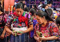 Chichicastenango, Guatemala.  Quiche (Kiche, K'iche') Women Wearing Embroidered Blouses Shopping in Indoor Market, Sunday Morning.
