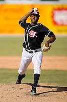 Relief pitcher Moises Robles (29) of the Hickory Crawdads in action versus the Charleston RiverDogs at L.P. Frans Stadium in Hickory, NC, Sunday, May 4, 2008.