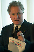 January 31 2003, Montreal, Quebec, Canada<br /> <br /> Jean Charest, Leader of  Quebec Liberal Party hold his party's program during  a speech , January 31 2003 in Montreal, Canada.<br /> <br /> Quebec Provincial elections will be held April 14, 2003<br /> Mandatory Credit: Photo by Pierre Roussel- Images Distribution. (©) Copyright 2003 by Pierre Roussel <br /> <br />  -