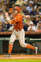 Christian Summers #5 of the Texas Longhorns follows through on his swing against the Rice Owls at Minute Maid Park on March 2, 2012 in Houston, Texas.  The Longhorns defeated the Owls 11-8.  (Brian Westerholt/Four Seam Images)