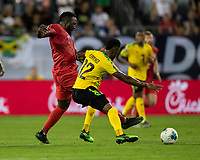 NASHVILLE, TN - JULY 3: Jozy Altidore #17 and Junior Flemmings #12 contest the ball during a game between Jamaica and USMNT at Nissan Stadium on July 3, 2019 in Nashville, Tennessee.