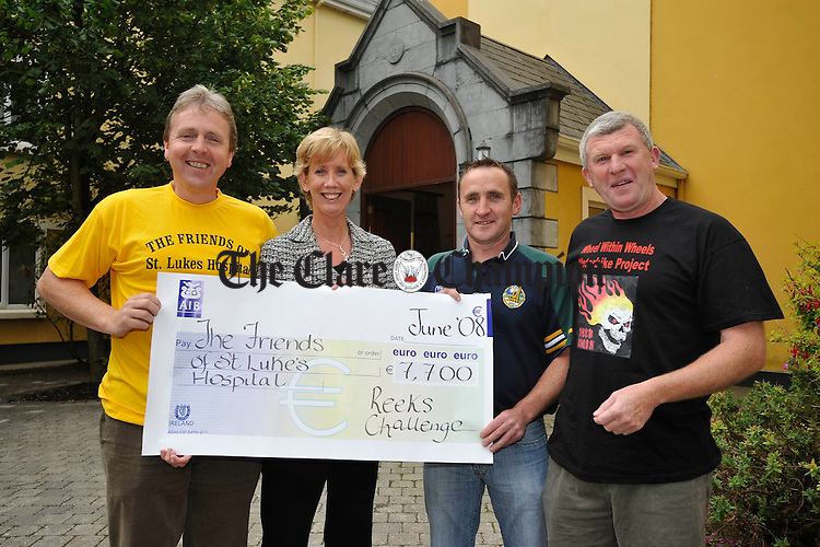 At the presentation of Ä7700 from the Reeks Challenge to friends of St Luke's Hospital, Dublin were, Jim Mc Mahon, climber, Deirdre Hughes, Appeals Director of the Friends OF St. Lukes, Chris Withycombe, climber and Jacko Mc Mahon, fundraiser with Wheels within Wheels motorbike project.
