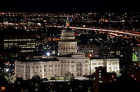 The Texas State Capitol at night as traffic car lights streak along Interstate I-35 during rush hour - Stock Image