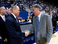11 November 2009:  Detroit head coach Ray McCallum shakes hands with California head coach Mike Montgomery before the game between Detroit and California at Haas Pavilion in Berkeley, California.   California defeated Detroit, 95-61.