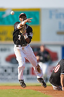 Second baseman Greg Picart (7) of the Hickory Crawdads turns a double play at L.P. Frans Stadium in Hickory, NC, Sunday, August 17, 2008.