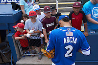 Biloxi Shuckers shortstop Orlando Arcia (2) signs autographs before a game against the Birmingham Barons on May 24, 2015 at Joe Davis Stadium in Huntsville, Alabama.  Birmingham defeated Biloxi 6-4 as the Shuckers are playing all games on the road, or neutral sites like their former home in Huntsville, until the teams new stadium is completed in early June.  (Mike Janes/Four Seam Images)
