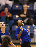 Marymount's Morgan McAlpin gets a dig against St. Mary's during a college volleyball game in Lexington Park, MD, on Wednesday, Oct. 29, 2014. Marymount won 3-2 to go 24-9 on the season.<br /> Photo by Cathleen Allison