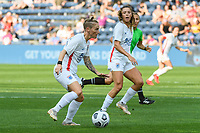BRIDGEVIEW, IL - JULY 18: Jessica Fishlock #10 of the OL Reign plays the ball during a game between OL Reign and Chicago Red Stars at SeatGeek Stadium on July 18, 2021 in Bridgeview, Illinois.
