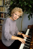 Montreal (Qc) CANADA - File Photo - September 24, 1987 - EXCLUSIVE PHOTO -<br /> France Castel plays the piano in her appartment at Cite du Parc.<br /> <br /> -Photo (c)  Images Distribution