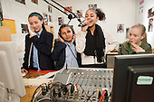 An after-school group in the radio studio at the New Avenues Youth Club, Queen's Park.