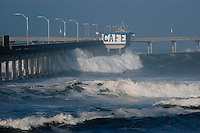 Surf rolls along the Ocean Beach pier in San Diego California, Wednesday, December 5 2007.  A large storm swell hit San Diego shores forcing the temporary closure of the Ocean Beach pier.
