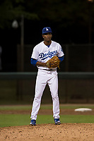 AZL Dodgers relief pitcher Jose Hernandez (47) checks the runner at first base during an Arizona League game against the AZL White Sox at Camelback Ranch on July 3, 2018 in Glendale, Arizona. The AZL Dodgers defeated the AZL White Sox by a score of 10-5. (Zachary Lucy/Four Seam Images)