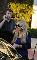 MIAMI BEACH, FL - JANUARY 1: (EXCLUSIVE COVERAGE) F1 heiress Petra Ecclestone and husband James Stunt along with friends which included Oil heir Brandon Davis (Brandon Davis brokered Petra Ecclestone $150m deal for Candy Spelling's LA mansion) spend the day poolside at their Miami Beach luxury hotel.   Petra Ecclestone (born December 1988) is a British-Croatian heiress, model, fashion designer and socialite, the younger daughter of Croatian former Armani model Slavica and Formula One billionaire Bernie Ecclestone. She has an older sister, Tamara and an older paternal half-sister, Deborah. She speaks Croatian fluently and understands French and Italian. On January 01, 2012 in Miami Beach, Florida  (Photo By Storms Media Group)   <br /> <br /> People:  Petra Ecclestone
