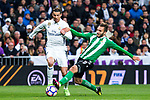 Cristiano Ronaldo of Real Madrid competes for the ball with  during the match of Spanish La Liga between Real Madrid and Real Betis at  Santiago Bernabeu Stadium in Madrid, Spain. March 12, 2017. (ALTERPHOTOS / Rodrigo Jimenez)