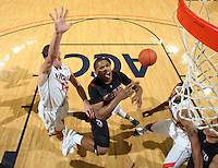 Dec. 22, 2010; Charlottesville, VA, USA; Seattle Redhawks guard Sterling Carter (10) is fouled by Virginia Cavaliers guard Joe Harris (12) during the game at the John Paul Jones Arena. Seattle Redhawks won 59-53. Mandatory Credit: Andrew Shurtleff