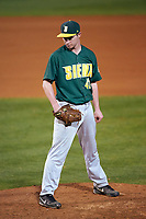 Siena Saints starting pitcher Tom Miller (42) looks in for the sign during a game against the Stetson Hatters on February 23, 2016 at Melching Field at Conrad Park in DeLand, Florida.  Stetson defeated Siena 5-3.  (Mike Janes/Four Seam Images)