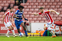 6th February 2021; Bet365 Stadium, Stoke, Staffordshire, England; English Football League Championship Football, Stoke City versus Reading; Ovie Ejaria of Reading under pressure from Nathan Collins of Stoke City