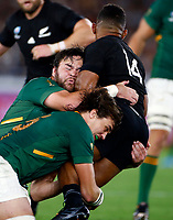 Frans Malherbe and Franco Mostert of South Africa tackling Sevu Reece of New Zealand (All Blacks) during the Rugby World Cup Pool B match between the New Zealand All Blacks and South Africa Springboks at the International Stadium in Yokohama, Japan on Saturday, 21 September, 2019. Photo: Steve Haag / stevehaagsports.com
