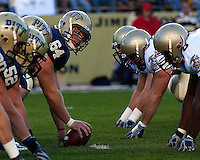 Pittsburgh center Robb Houser (64) takes a peak at the Navy defenders. The Pittsburgh Panthers defeated the Navy Midshipmen 27-14 at Heinz Field, Pittsburgh, PA.