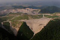 Mountaintop removal is a mining practice drastically transforming Appalachia.  It is an antiseptic term used to describe the most profound assault on land imaginable.  <br /> <br /> Like a cancerous mutation of strip mining, entire mountaintops are blasted away to obtain a small seam of coal.  Unwanted rock is pushed into valleys and streams, destroying natural watersheds, leaving no vegetation, and turning the terrain into unusable land.  <br /> <br /> So many small streambeds are dumped with the excess rock and dirt that the length of the Ohio River is filled in.