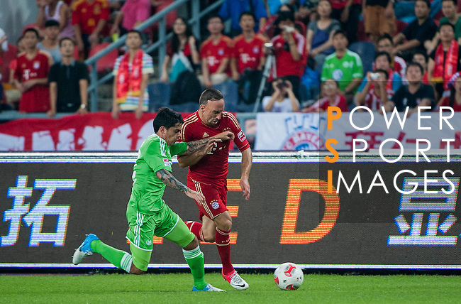 Franck Ribery of Bayern Munich and Vasco Da Gama's Fagner of Wolfsburg in action during a friendly match as part of the Audi Football Summit 2012 on July 26, 2012 at the Guangdong Olympic Sports Center in Guangzhou, China. Photo by Victor Fraile / The Power of Sport Images