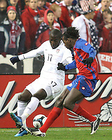 Jozy Altidore #17 of the USA pulls the ball away from Dennis Marshall #5 of Costa Rica during a 2010 World Cup qualifying match in the CONCACAF region at RFK Stadium on October 14 2009, in Washington D.C.The match ended in a 2-2 tie.