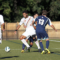 Boston College forward Charlie Rugg (17) under pressure attempts to control the ball. Boston College defeated University of Rhode Island, 4-2, at Newton Campus Field, September 25, 2012.