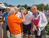 Netherlands, Amstelveen, August 23, 2015, Tennis,  National Veteran Championships, NVK, TV de Kegel,  awards ceremony, Winners men's doubles, 60+, Rolf Thung  and runner up Martin Koek (R) receive their medals<br /> Photo: Tennisimages/Henk Koster