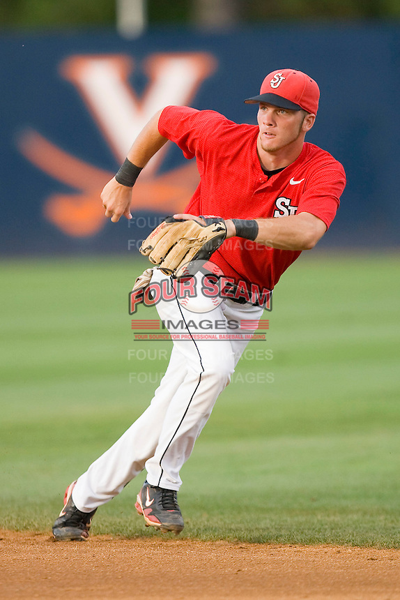Second baseman Matt Wessinger #0 of the St. John's Red Storm tracks a ground ball against the Virginia Cavaliers at the Charlottesville Regional of the 2010 College World Series at Davenport Field on June 6, 2010, in Charlottesville, Virginia.  The Red Storm defeated the Cavaliers 6-5.   Photo by Brian Westerholt / Four Seam Images