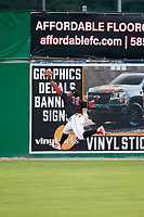 Batavia Muckdogs left fielder Albert Guaimaro (13) makes a leaping catch during a game against the Lowell Spinners on July 16, 2018 at Dwyer Stadium in Batavia, New York.  Lowell defeated Batavia 4-3.  (Mike Janes/Four Seam Images)