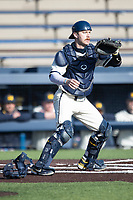 Michigan Wolverines catcher Griffin Mazur (13) waits for a throw to the plate during the NCAA baseball game against the Illinois Fighting Illini at Fisher Stadium on March 19, 2021 in Ann Arbor, Michigan. Illinois won the game 7-4. (Andrew Woolley/Four Seam Images)