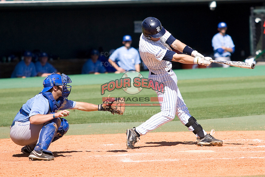Rice Owls second baseman Michael Ratterree #8 swings against the Memphis TIgers in NCAA Conference USA baseball on May 14, 2011 at Reckling Park in Houston, Texas. (Photo by Andrew Woolley / Four Seam Images)