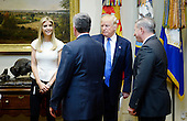 United States President Donald Trump and daughter Ivanka Trump greet participants including Brian A. Gallagher, President and Chief Executive Officer of United Way Worldwide (L) and John Richmond (R) ,a federal prosecutor serving as the Special Litigation Counsel with the U.S. Department of Justice's Human Trafficking Prosecution Unit before a listening session on domestic and international human trafficking in the Roosevelt Room of the White House on February 23, 2017 in Washington, DC. <br /> Credit: Olivier Douliery / Pool via CNP
