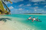 Family enjoying a canoe ride at Aitutaki Lagoon Resort & Spa on Aitutaki, Cook Islands