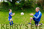 Declan Quille and his son Adam hosting Skilz Skool - tips for young footballers through Facebook videos at their home in Tralee on Tuesday