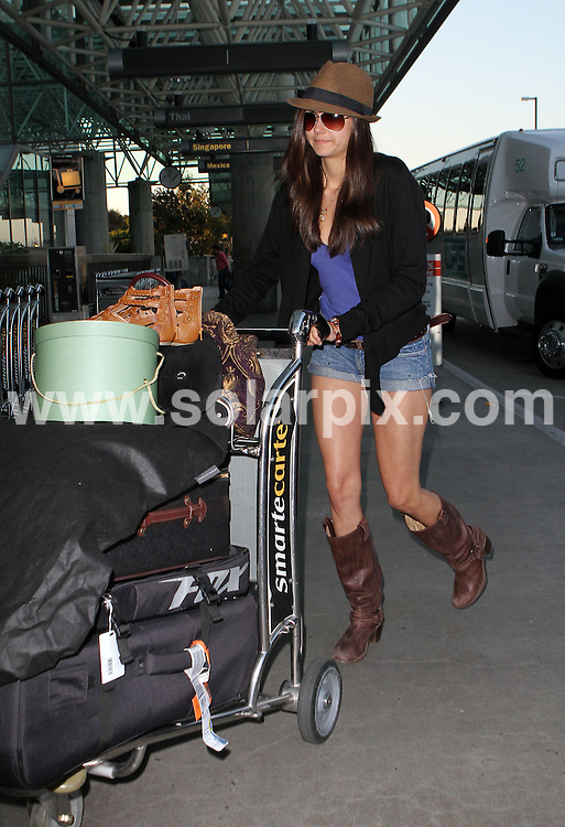 **ALL ROUND PICTURES FROM SOLARPIX.COM**.**SYNDICATION RIGHTS FOR UK AND SPAIN ONLY**.Bulgarian-Canadian actress Nina Dobrev, star of TV series - Vampire Diaries - was pictured departing from Los Angeles LAX airport, in California, USA to board a flight to London. Los Angeles, USA. 30 May 2010..This pic: Nina Dobrev..JOB REF: 11380 PRT        DATE: 30_05_2010.**MUST CREDIT SOLARPIX.COM OR DOUBLE FEE WILL BE CHARGED**.**MUST NOTIFY SOLARPIX OF ONLINE USAGE**.**CALL US ON: +34 952 811 768 or LOW RATE FROM UK 0844 617 7637**