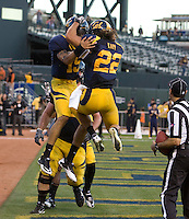 Zach Maynard of California celebrates with Will Kapp of California after Maynard scored a touchdown during the game against Utah at AT&T Park in San Francisco, California on October 22, 2011.   California defeated Utah, 34-10.