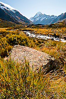Looking through the Hooker Valley and across Hooker River towards highest mountain in New Zealand - Mt. Cook 3754m  - Mt. Cook National Park, Mackenzie Country, New Zealand