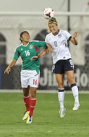 Kristie Mewis (8) of the USWNT heads the ball against Stephany Mayor (16) of Mexico.  The USWNT defeated Mexico 7-0 during an international friendly, at RFK Stadium, Tuesday September 3 , 2013.