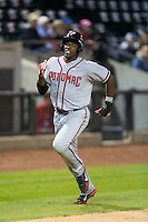 Isaac Ballou (10) of the Potomac Nationals hustles towards home plate against the Winston-Salem Dash at BB&T Ballpark on April 30, 2015 in Winston-Salem, North Carolina.  The Nationals defeated the Dash 5-4..  (Brian Westerholt/Four Seam Images)