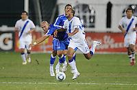 Guatemala midfielder Fredy Thompson (15) gets fouled by El Salvador midfielder Denis Alas (14)    The Guatemalan National Team defeated  El Salvador National Team 2-0 in a friendly international at RFK Stadium, Saturday September 7, 2010.