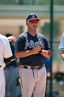 GCL Braves manager Nestor Perez (4) during the lineup exchange before a Gulf Coast League game against the GCL Pirates on July 30, 2019 at Pirate City in Bradenton, Florida.  GCL Braves defeated the GCL Pirates 10-4.  (Mike Janes/Four Seam Images)