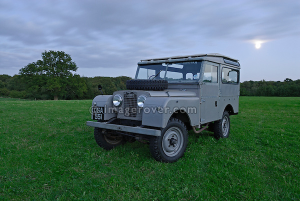 Very original historic 1950s Landrover Series 1 88in Station Wagon of the Dunsfold Collection on a moonlit field in Surrey, south England. Europe, UK, England, Surrey, Dunsfold. --- RIGHTS PROTECTION AVAILABLE ON REQUEST. Automotive trademarks are the property of the trademark holder, authorization may be needed for some uses.