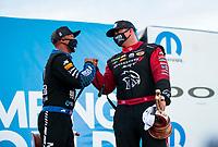 Nov 1, 2020; Las Vegas, Nevada, USA; NHRA top fuel driver Antron Brown (left) celebrates with funny car driver Matt Hagan after winning the NHRA Finals at The Strip at Las Vegas Motor Speedway. Mandatory Credit: Mark J. Rebilas-USA TODAY Sports