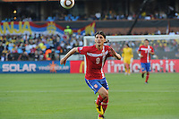 Serbian forward Marko Pantelic keeps an eye on the ball entering the attacking third. Ghana defeated Serbia, 1-0, June 13th, in the opening match of Group D of the 2010 FIFA World Cup.