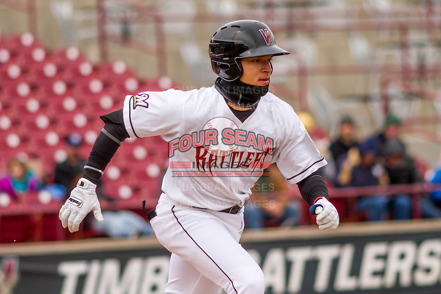 Wisconsin Timber Rattlers shortstop Isan Diaz (6) runs to first during a Midwest League game against the Beloit Snappers on April 10th, 2016 at Fox Cities Stadium in Appleton, Wisconsin.  Wisconsin defeated Beloit  4-2. (Brad Krause/Four Seam Images)