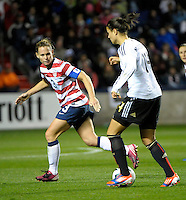 US defender Christie Rampone (3) eyes Germany's Dzsenifer Maroszsan (14).  The U.S. Women's National Team tied Germany 1-1 in a friendly at Toyota Park in Bridgeview, IL on October 20, 2012.