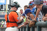 Miami Hurricanes catcher Zack Collins (0) signs autographs before Game 5 of the NCAA College World Series against the UC Santa Barbara Gauchos in on June 20, 2016 at TD Ameritrade Park in Omaha, Nebraska. UC Santa Barbara defeated Miami  5-3. (Andrew Woolley/Four Seam Images)